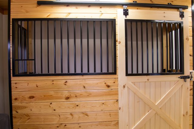 Black Grating on Wooden Stall