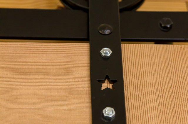 Black Metal Trim on Wooden Rolling Door