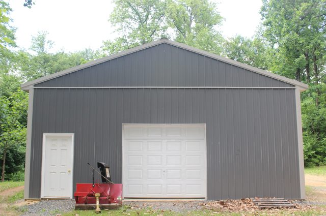 Dark Gray Pole Barn and White Door