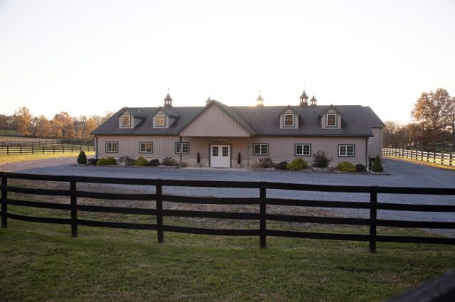 Horse Barn Surrounded By Fence