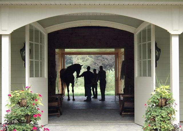 Horse riders in two-level barn
