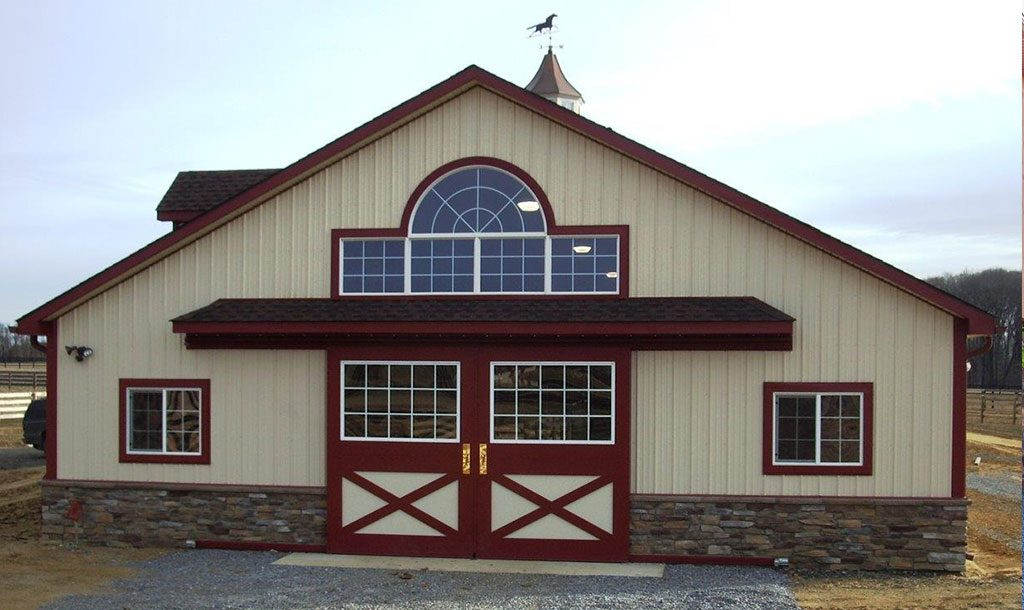 Custom horse barn designed by New Holland Supply