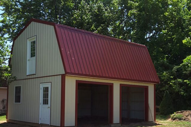 Large garage with red metal roof