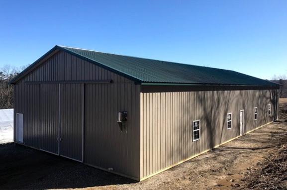 Big gray pole barn with metal roof