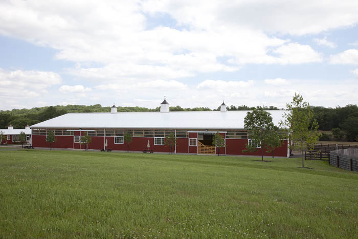 Large red horse barn design