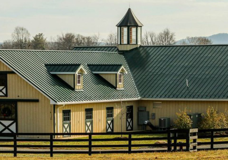 Large yellow custom horse barn