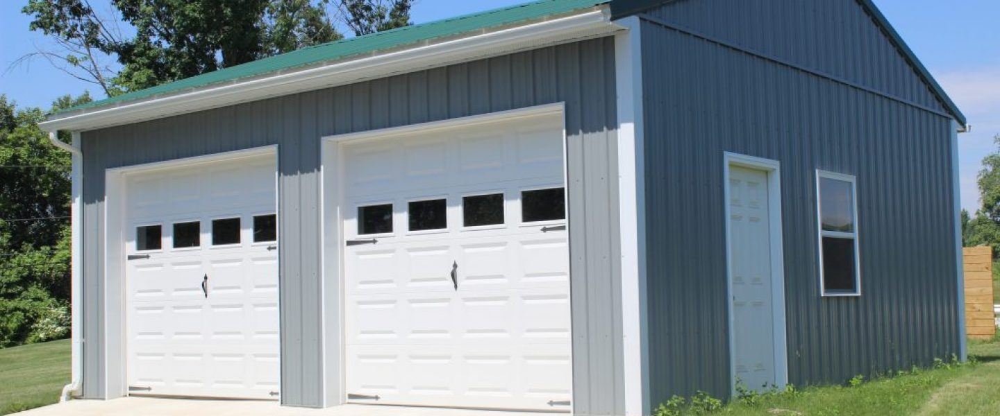 Pole barn garage with green metal roof