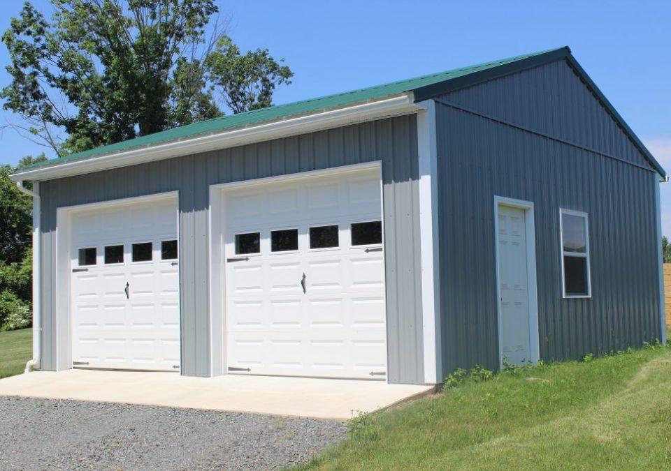 Pole barn garage with green metal roof