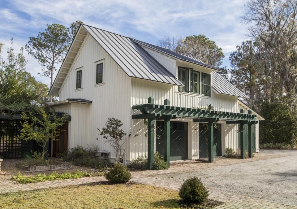 Farmhouse garage with pergola